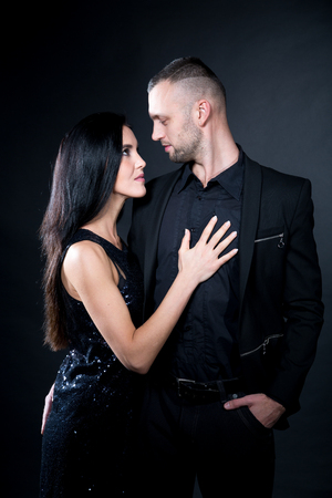 Lovers role-playing games. Dominate obey undress seduce a partner. Feel emotions hand touch, romantic lover desire. Beauty model brunette long hair. Sensual date conceptual idea. Thematic bdsm party