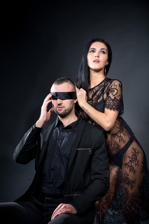 Lovers role-playing games. Dominate obey undress seduce a partner. Blindfold mask secret. Feel emotions hand touch. Beauty model brunette long hair. Sensual date conceptual idea. Thematic bdsm party