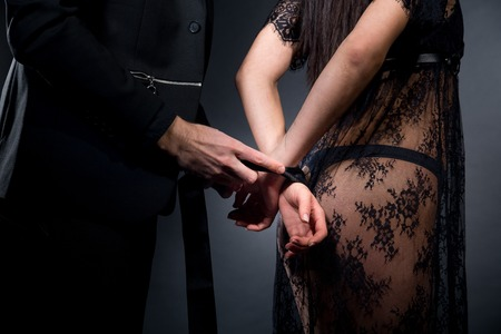 Lovers role-playing games. Dominate obey undress seduce a partner. Feel emotions hand touch. Beauty model brunette long hair, close body. Sensual date conceptual idea. Thematic party dark night