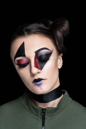 New creative make-up, conceptual idea, Hallowen club party. Black red bold color graphic shapes cubism, cosmetics shadows paints lines lips. Professional close-up photo. crazy skin painting artistic
