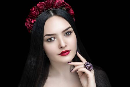 Beautiful woman close up portrait. Professional make up glossy beige eyeshadows, long lashes, new red matte lipstick. Elegant hair style, massive art accessory. Horizontal banner free place background