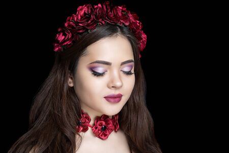 Beautiful woman close up portrait. Professional make up, eyeshadows, long lashes, new matte lipstick. Elegant hair style, massive flower wreath tiara accessory. Horizontal banner free place background