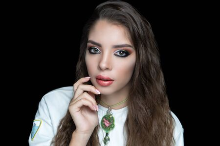 Close up portrait beautiful woman, design art jewellery necklace. Face Fashion model stylish trendy make up, fake lash extensions big eyes, glossy lipstick lipgloss, curly haircare. Pretty girl posing Stock fotó - 127791617