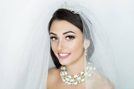 Beautiful woman close up portrait. Professional make up glossy eyeshadows, long lashes, new matte lipstick. Elegant hair style, massive silver crown accessory. Horizontal banner, free place background Stock fotó - 130497234