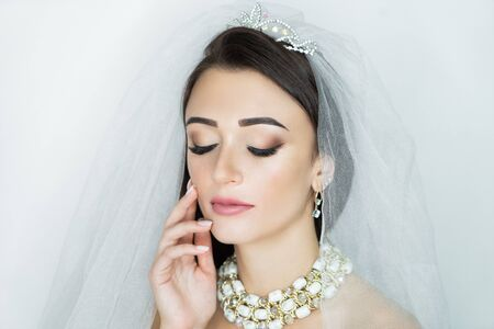 Beautiful woman close up portrait. Professional make up glossy eyeshadows, long lashes, new matte lipstick. Elegant hair style, massive silver crown accessory. Horizontal banner, free place background Stock fotó - 130497263