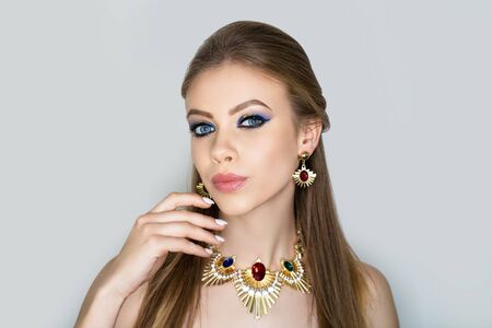 Beautiful woman. Bright makeup, shades shadows blending pencil technique. Evening hairstyle long straight hair. background horizontal banner. Big necklace massive accessory, shiny bijou. manicure 写真素材