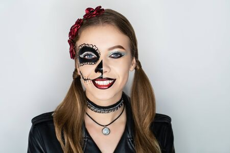 New creative make up funny human sugar skull, red flowers wreath. applied to face-art Mexican celebration, Day of the Dead Dia de los Muertos, Roman Catholic holiday All Souls Day. horizontal banner