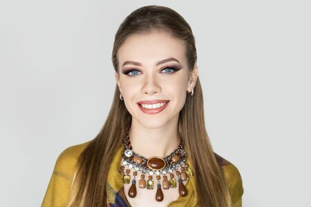 Beautiful woman. Bright makeup, shades shadows blending pencil technique. Evening hairstyle long straight hair. background horizontal banner. Big necklace massive accessory, brown beige beads. Natural