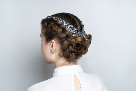Close-up portrait beauty girl woman lady, volume hair-do. Luxury hair styling. new concept. Woman medium length hair. Wedding hairstyle gathered hair-do braided flowers. Beautiful bride style creative 스톡 콘텐츠 - 151912377