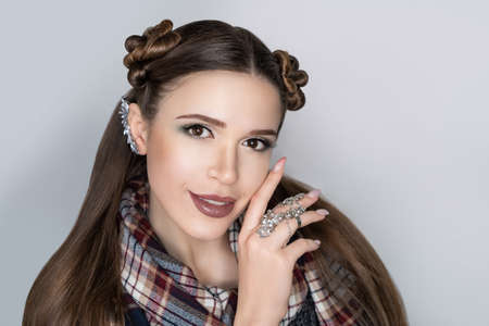 Close-up portrait beauty girl woman lady, volume hair-do. Luxury hair styling. new concept. Woman length hair. Casual hairstyle gathered hair-do flowers. Beautiful city look scarf traditional style