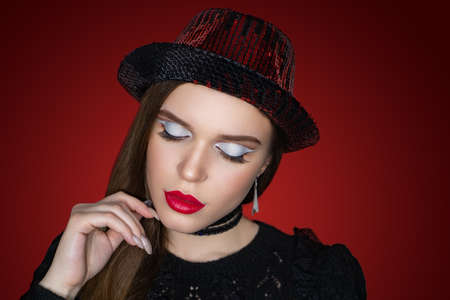 Beautiful woman close up portrait. Professional make up white eyeshadows, long lashes, new matte red lipstick. Elegant hair style, massive accessory choker. Horizontal banner, gradient background