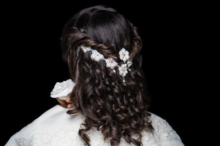 Close-up portrait of beautiful girl with volume hair-do. Luxury hair styling. Woman with braided medium length hair. Wedding hairstyle gathered hair-do flowers. Beauty bride style, creative jewelry