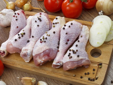drumstick: chicken drumstick with vegetables on wooden table Stock Photo