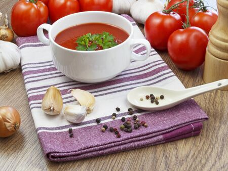 gazpacho: summer gazpacho soup with vegetables on wooden table