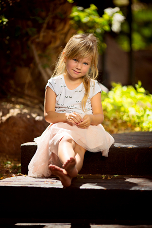 A four year old girl blond girl enjoying summer vacations