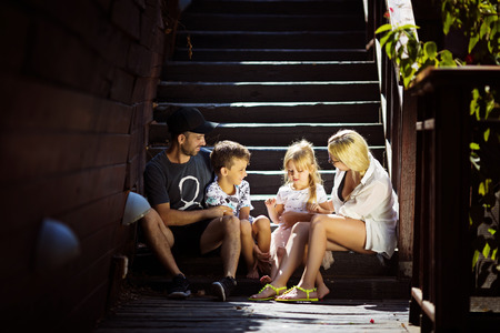 Family happiness generation home and people concept happy family standing in front of house