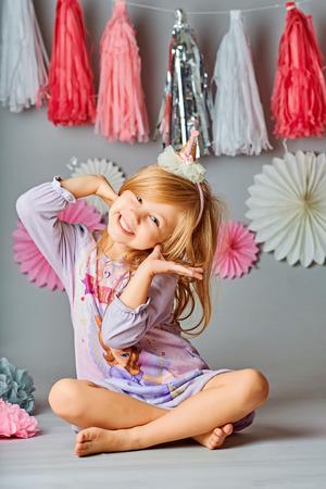 Cute girl year old posing in studio