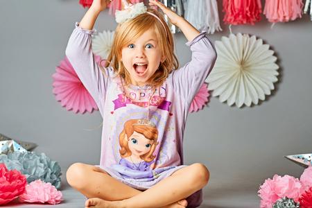 Cute girl 4-5 year old posing in studio