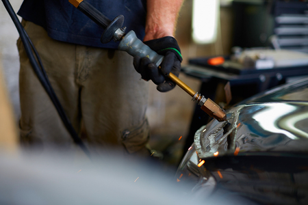 Close up hands of unrecognizable mechanic doing car service and maintenance Stock fotó