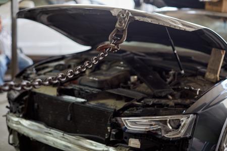 Car mechanic in the car service repairing dents on the car body. Stock fotó
