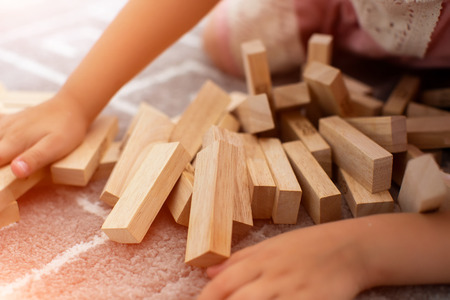Janga. Close-up photo. Imbalance. Collapse and destruction. Mistake. Entertainment activity. Game of physical and mental skill. Removing blocks