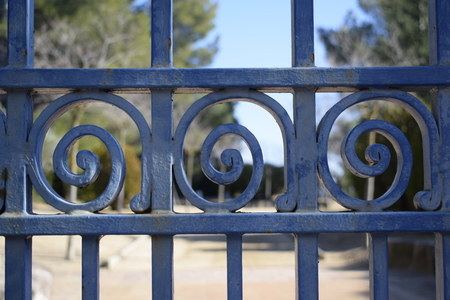 Blue spiral fence, iron, park background