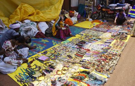 locals: GOKARNA, KARNATAKA, INDIA - FEBRUARY 27, 2014: locals sell cheap jewelry on the market, february 27, 2014,  in Gokarna, Karnataka, India.