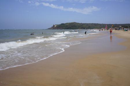 locals: GOA, INDIA - FEBRUARY 27, 2014: locals and tourists relax on the beach Baga, february 25, 2014 in Goa, India.