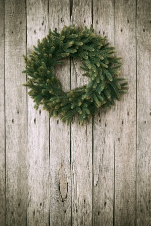 Green Christmas Wreath on Wooden Background photo