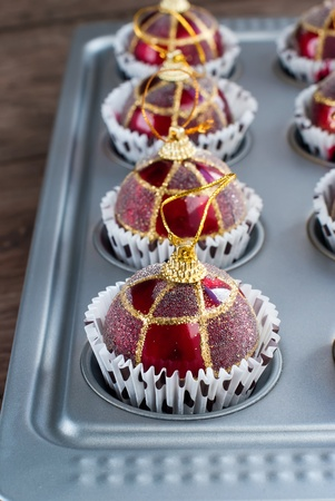 Funny Red Christmas Balls in Baking Sheet by Christmas Preparation photo