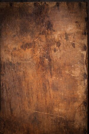 wood craft: Old Wooden Panel with the Hammered Rusty Nails on the Edge Stock Photo