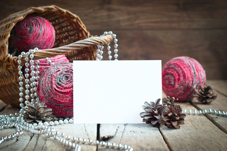 Christmas Card with White Sheet for Text, Pine Cones, Beads and Pink Natural Balls photo