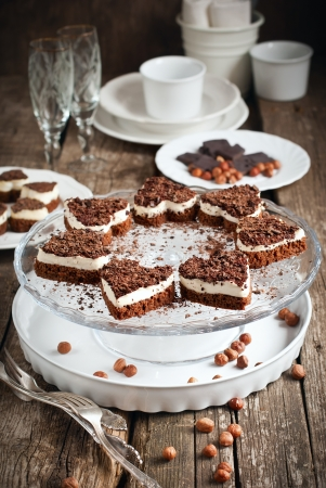Biscuit Cake in the Shape of Heart with White Custard and Chocolate on Festive Wooden Table photo