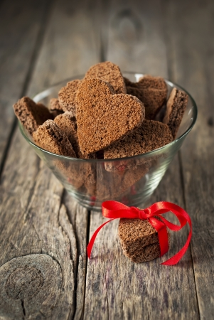 Chocolate Cookies in the Shape of Heart at Day St Valentine on Wooden Background Standard-Bild