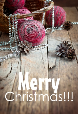 Magic Christmas Card with Pink Natural Balls, Pine Cones, Beads on Wooden Background photo