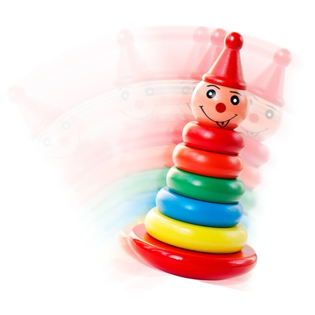 Bright Wooden Toy Pyramid Tumbler Toy Isolated on a White Background photo