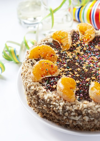 Cake  Decorated with Orange and sugar Sprinkles on white background photo