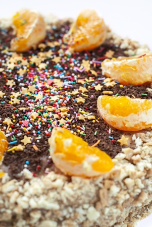 segmentar: Pastel decorado con Orange segmento y Sprinkles