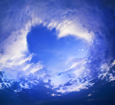 Clouds in the shape of Heart on blue sky, background photo