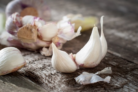 Organic Segments of Garlic on the Wooden Table, selective focus photo