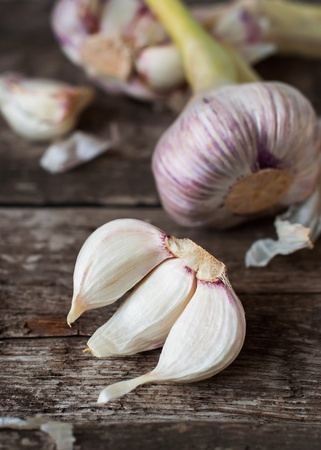 Segments of Garlic on the Wooden Table, selective focus photo