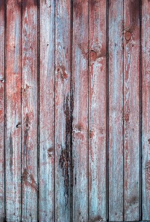 wood fence: Old Wooden Planks in the Row of red and blue color, background Stock Photo