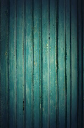 splintered: Old Blue Wooden Planks with cracked color paint, background with vignette Stock Photo