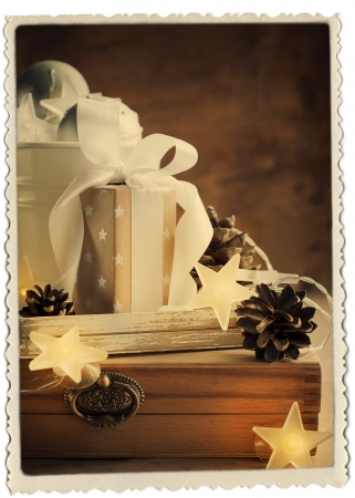 Vintage Christmas Card with Gifts, box, white ribbon and pine cones, retro photo frame photo