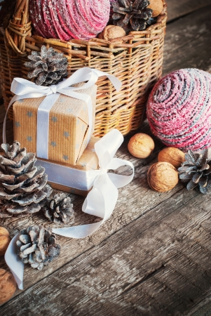 Christmas Composition with box, basket, pine cones and walnuts, close up