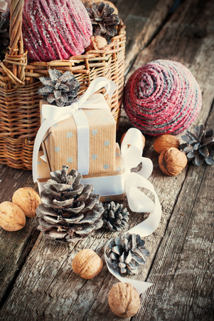 Christmas Compositiond with box, basket, pine cones and walnuts  photo