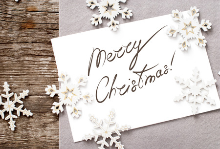 Christmas Card with Message Merry Christmas on the letter isolated on white, decorated snowflakes photo