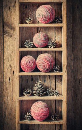 Vintage Christmas Gifts on rural shelf, wooden background photo