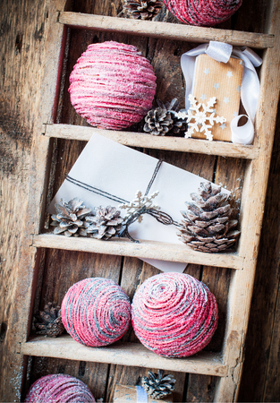 Vintage Christmas Natural Gifts on rural shelf, wooden background photo