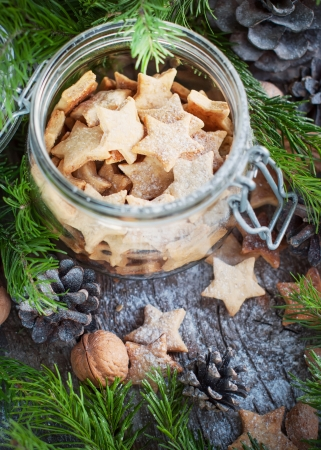 christmas eve: Christmas Cookies Stars in the glass jar with Fir Tree, top view
